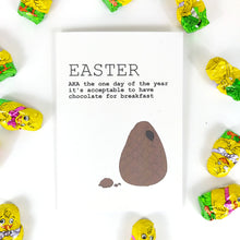 Load image into Gallery viewer, White card featuring an unwrapped broken easter egg with a bit of chocolate near it. To the top left of the card are the words EASTER AKA the one day of the year it's acceptable to have chocolate for breakfast' in black writing. Behind the card is a white background, and around the card you can see yellow chick chocolates.