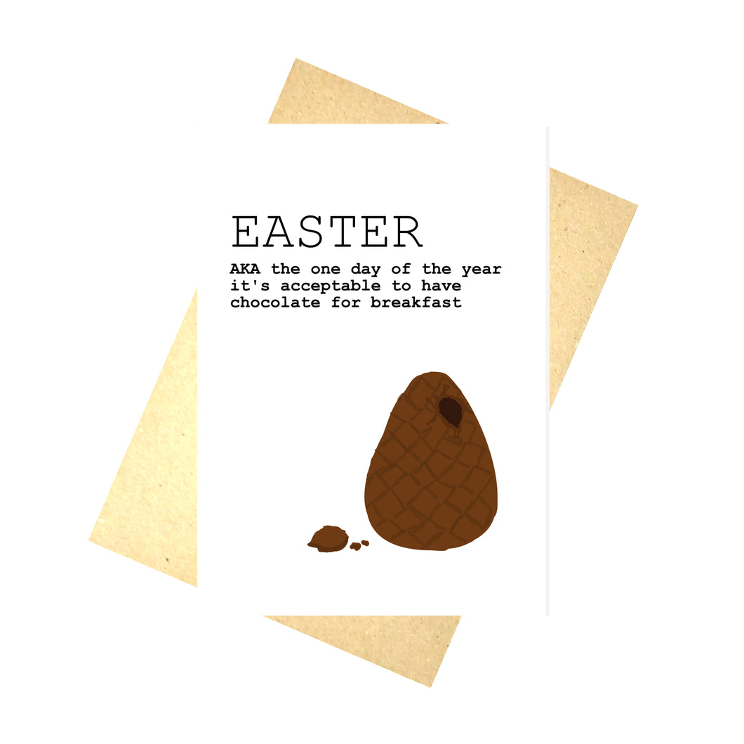 White card featuring an unwrapped broken easter egg with a bit of chocolate near it. To the top left of the card are the words EASTER AKA the one day of the year it's acceptable to have chocolate for breakfast' in black writing. Behind the card is a brown recycled envelope, behind which is a white background.