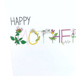 A close up of the card showing the detail in the floral lettering.