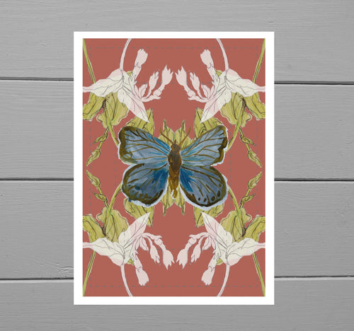Blue Butterfly Print with a warm orange background featuring green bindweed and white wildflowers behind a blue butterfly illustration. Behind the print is a grey wooden plank background.