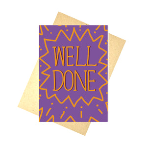 A rich purple card on a brown envelope, on top of a white background. The card features the words WELL DONE in the middle of a simple pattern. The writing and pattern are both in orange, with a deep plum partially outlining the words so they pop from the page.