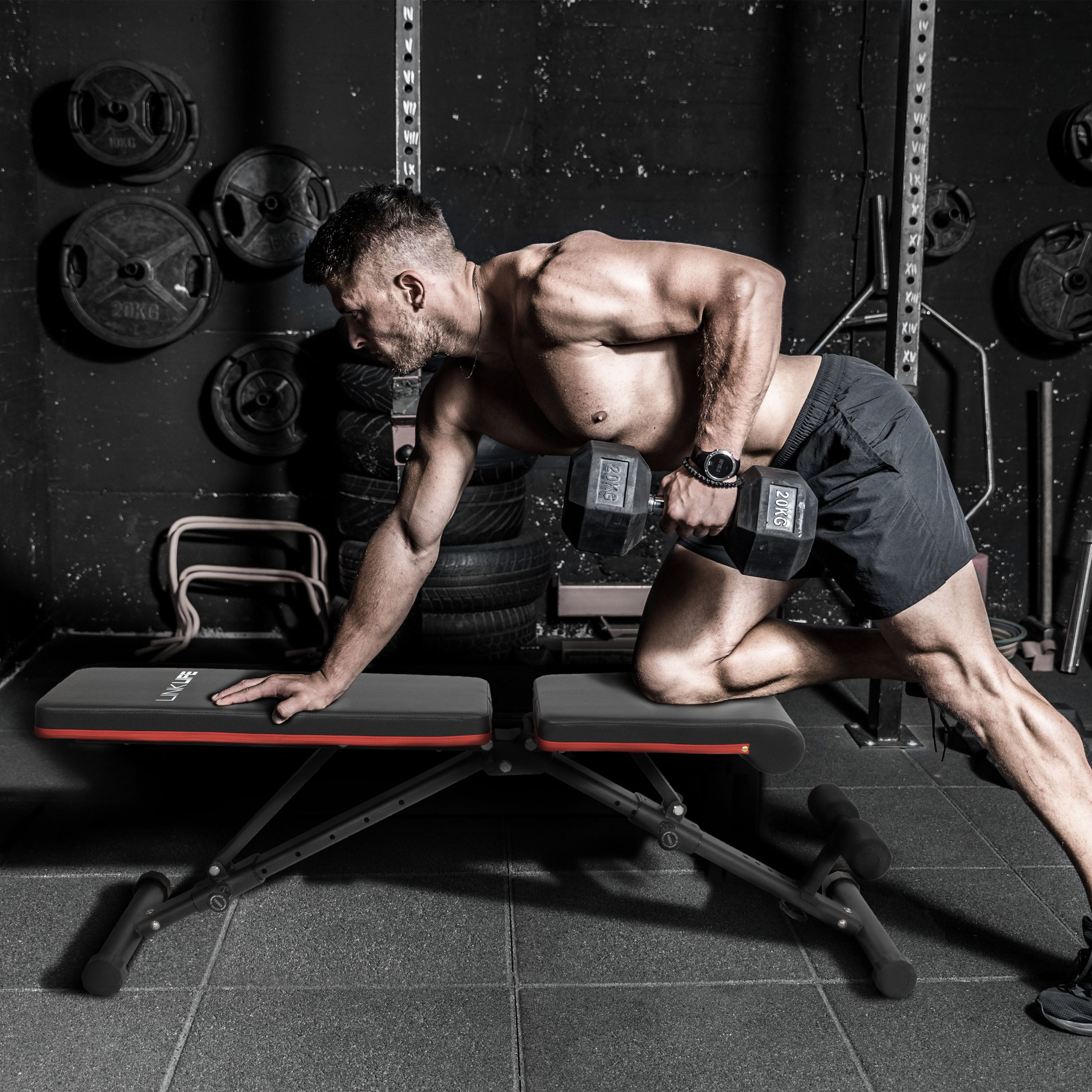 An image of a man using the workout bench.