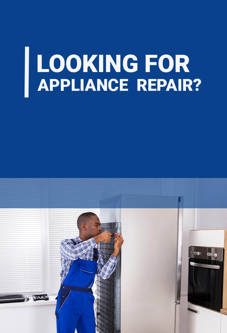 A working repairman from an Edmonton appliance services company
