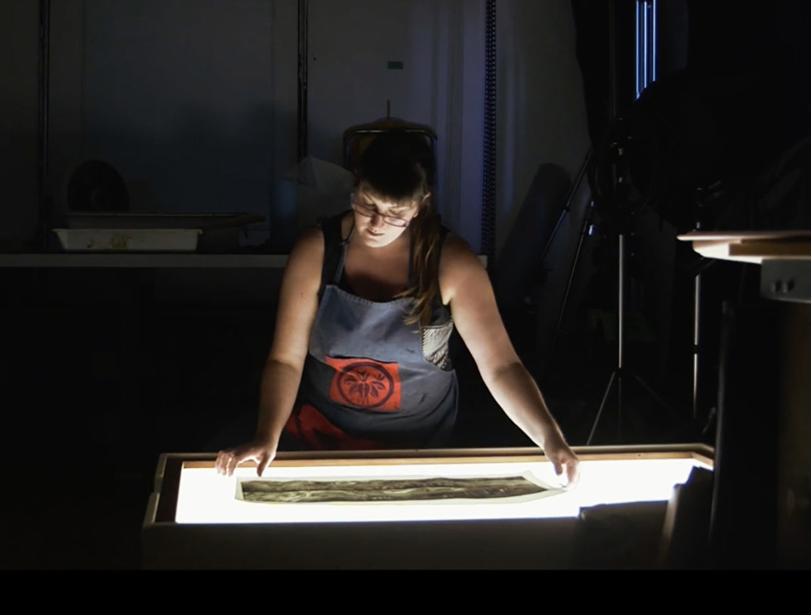 Natalie Draz looking at a light table
