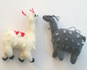 A Pair Stuffed Knitted Llamas and Alpacas. Made by hand in Peru.