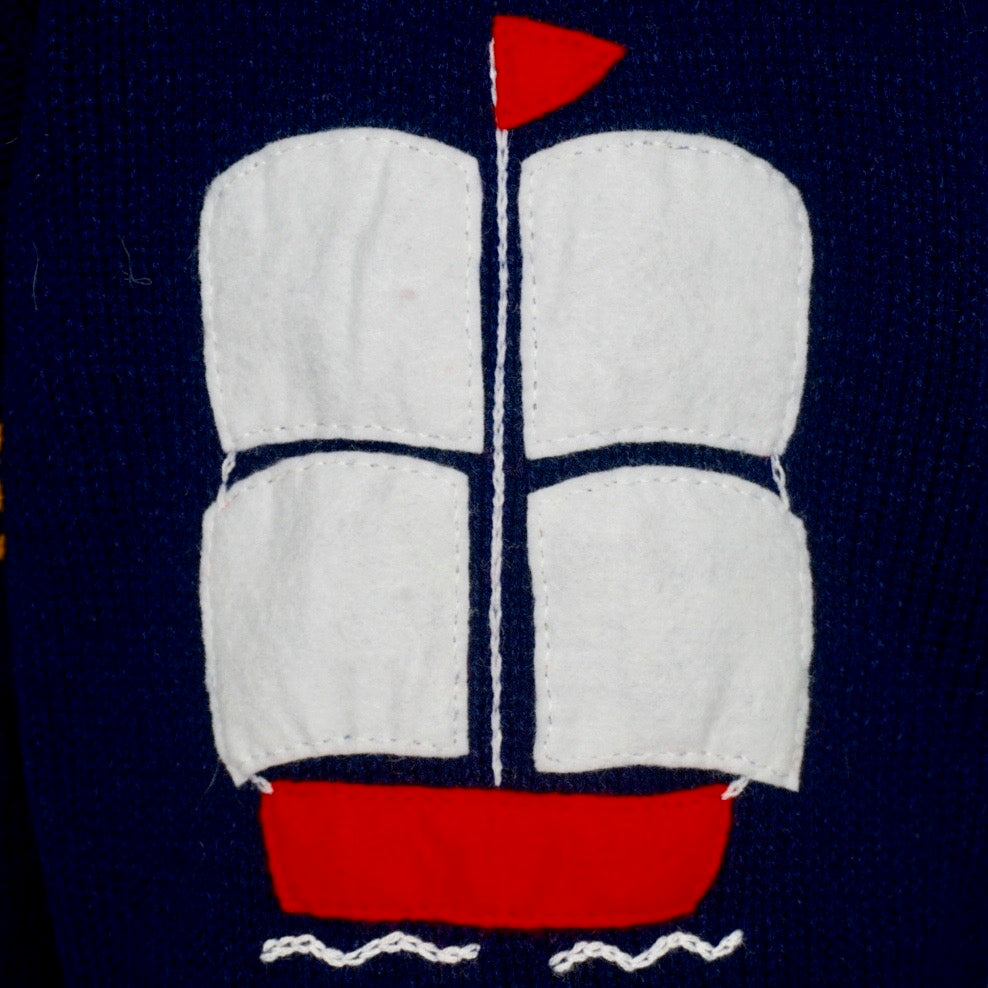 Boy's Admiral Jumper in navy blue with a hood and zip front.
