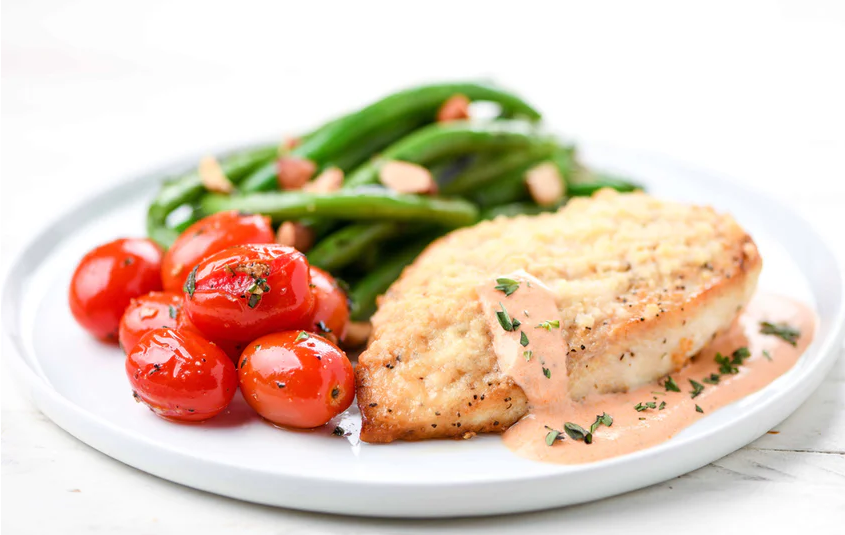 Chicken in Oregano-Tomato Cream with blistered tomatoes and green beans