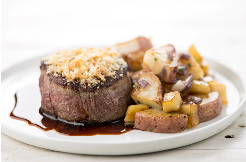 Garlic-Parmesan Crusted Filet Mignon with red wine sauce, roasted red potatoes and parsnips