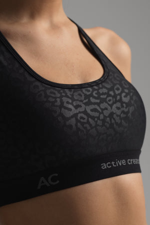 Luster Sports Bra in subtle black animal print (front view)