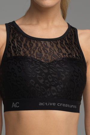 Treasure Chest sports bra in black animal print lace (front view)