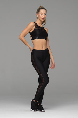 Laced full length legging in solid black, with black animal print lace panel down the side of each leg (side view)