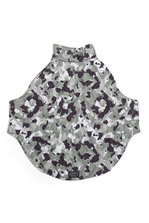 Foxtrot Dog Jacket in Camo Print laid on floor to show exterior of jacket when opened.
