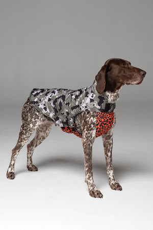Side profile of Foxtrot Dog Jacket, showing camo print body, and vibrant orange animal print bodice that covers chest and stomach.