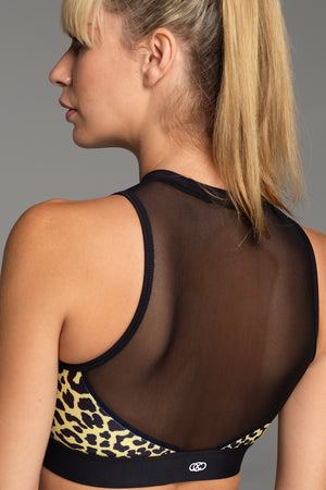 Tour of Duty Sports Bra in Blue Zebra Print, showing black mesh back and yellow & black animal print panel.