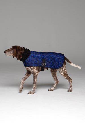 Side profile of Liberbarkce Dog Coat in Blue Zebra showing buckle closure and length of jacket which extends to the tail.