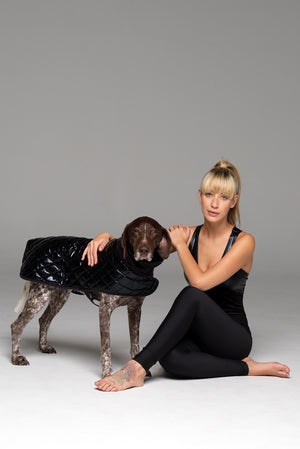 "Dog in Alpha coat and Model in matching full piece ""Night Call"" catsuit."