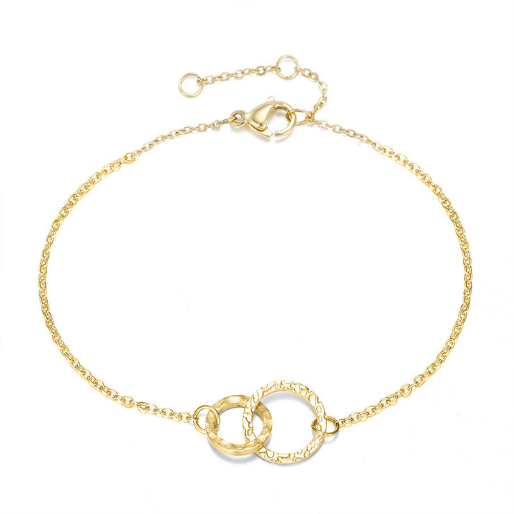 Brief 316 L stainless steel gold plated round hollow bracelet