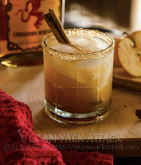 Apple Pie on the Rocks with a cinnamon stick stirrer and sugar rim
