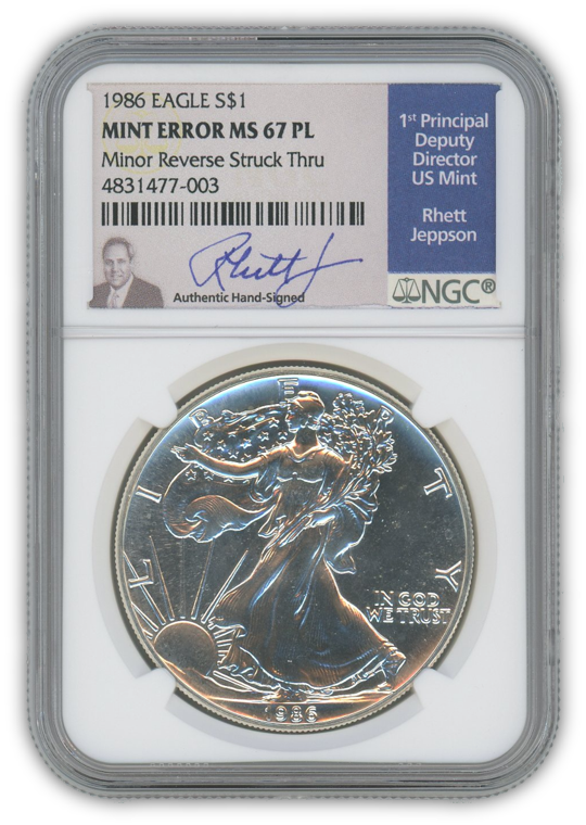 1986 Silver Eagle - Business Strike - Strike Through Error - NGC MS67PL Prooflike Jepson Label