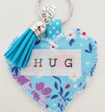 Load image into Gallery viewer, Handmade Pocket Hug heart fabric keyring with tassel - Cornflower Blue Floral Print - bag charm - keychain - missing you gift - stay safe gift