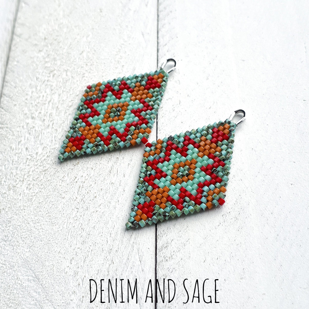 Turquoise, red and burnt orange beaded earrings. Indigenous handmade.