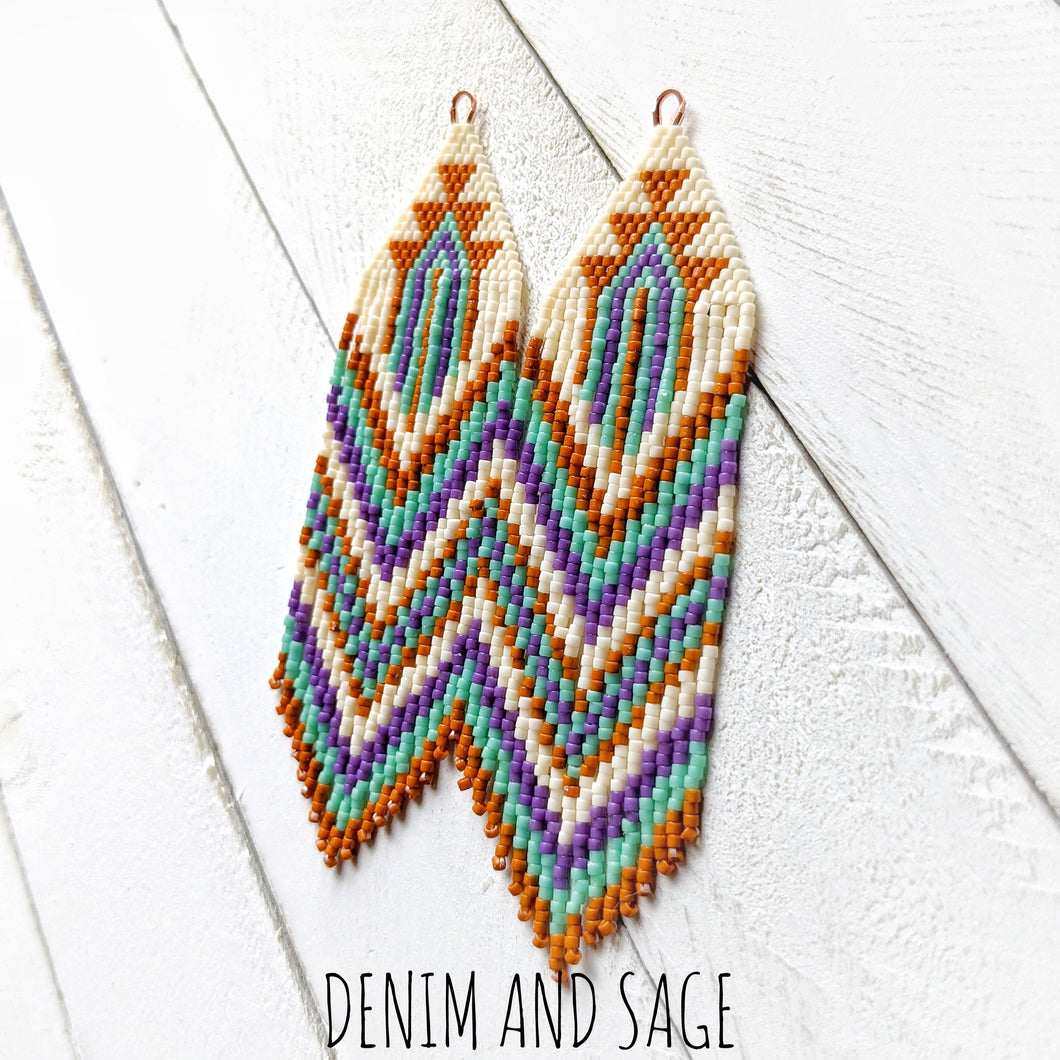 Burnt orange, purple, green and cream beaded fringe earrings. Indigenous handmade.