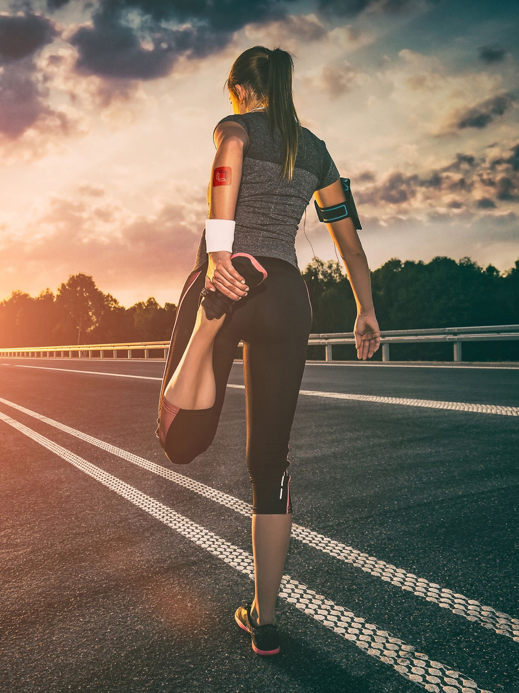 girl stretching her legs wearing the Microlayer performance patch