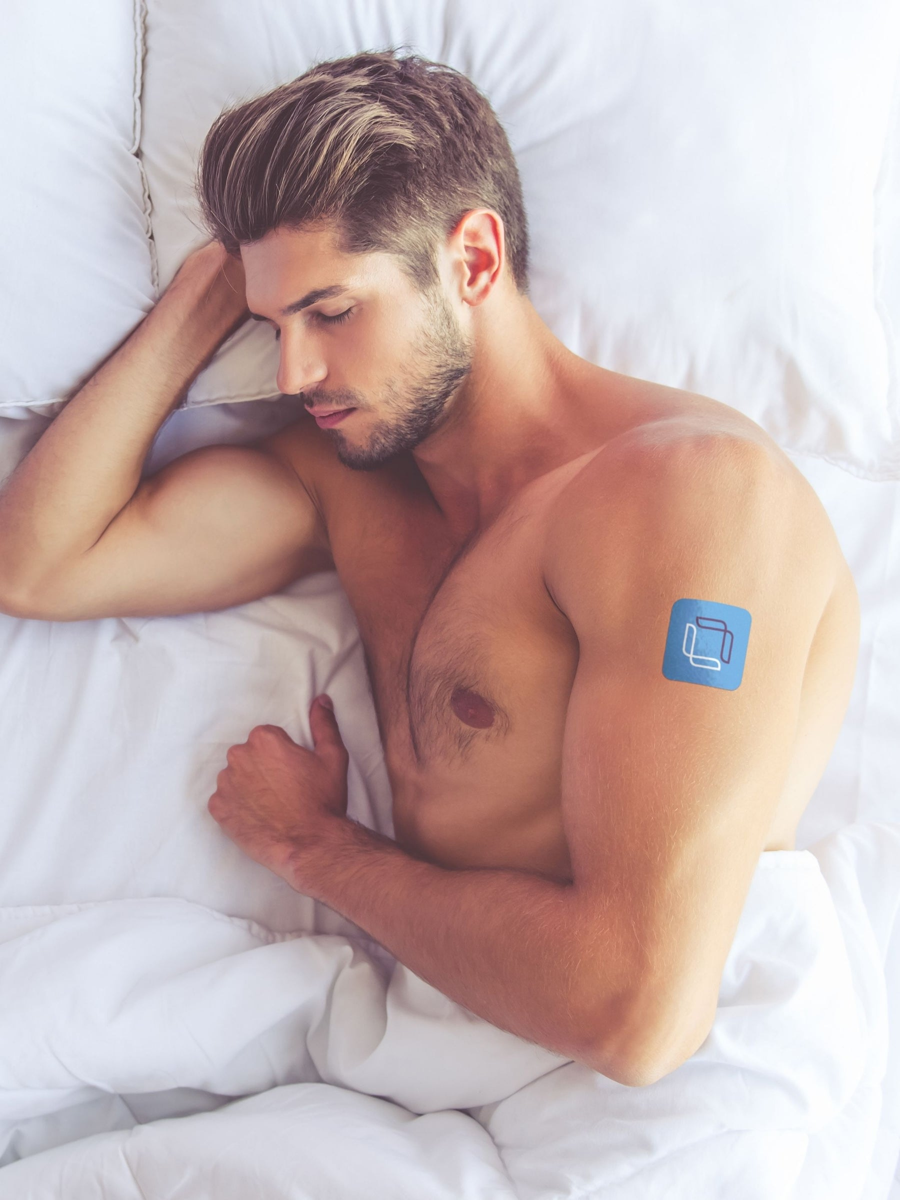 Guy sleeping in bed wearing a Microlayer sleeping patch