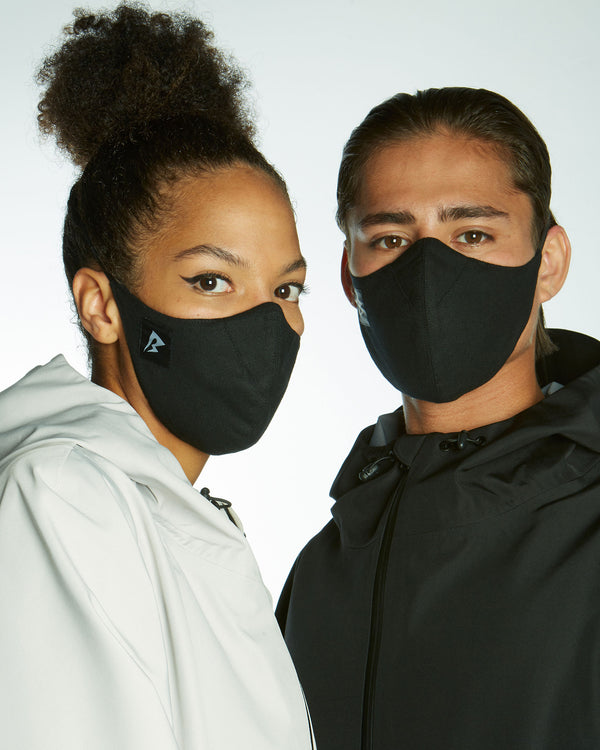 black face mask with HEPA filter protection, comfortable fit avoiding ears and made from sustainable eco cotton.
