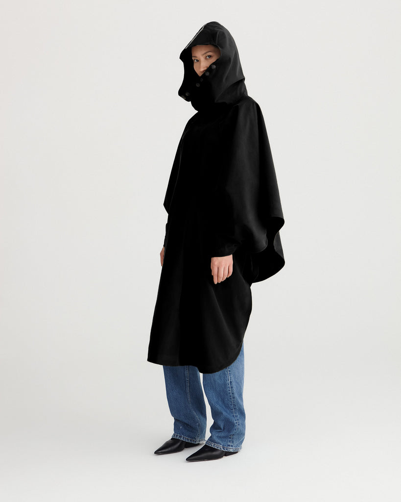 Black, waterproof, breathable, technical, sustainable and packable raincoat poncho suitable for cycling