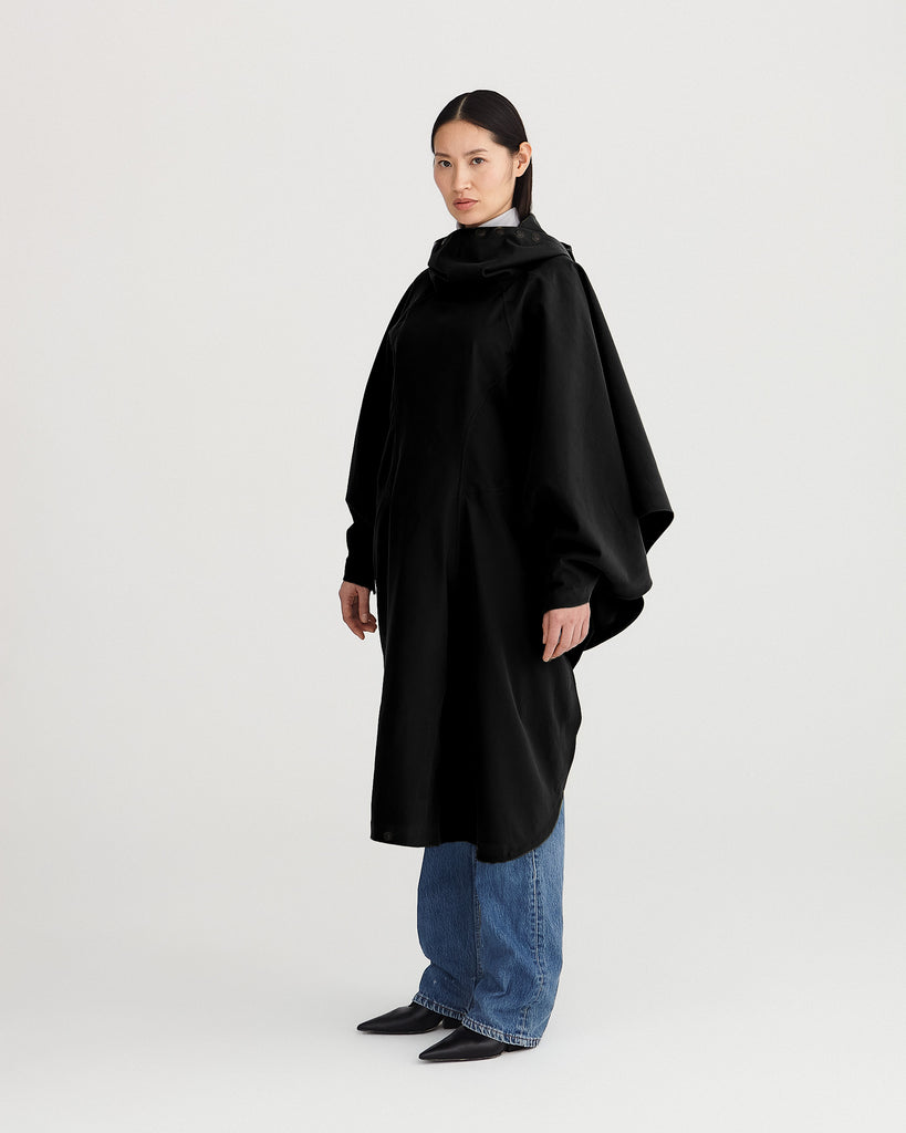 black, waterproof, breathable, sustainable, technica; and packable rain poncho suitable for cycling on bike.