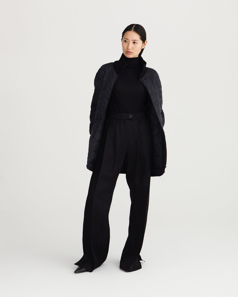 sustainable, zipped, black, detachable liner for raincoat made from 100% recycled polyester