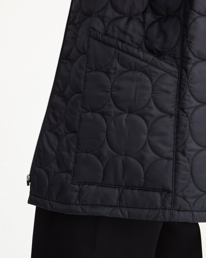 Close up of the sustainable, zipped, black, detachable liner for raincoat made from 100% recycled polyester
