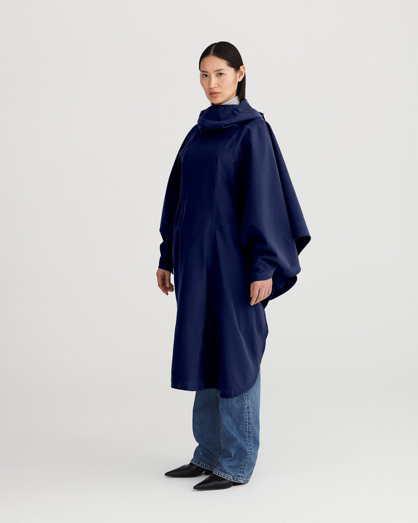 blue, waterproof, breathable, sustainable, technica; and packable rain poncho suitable for cycling