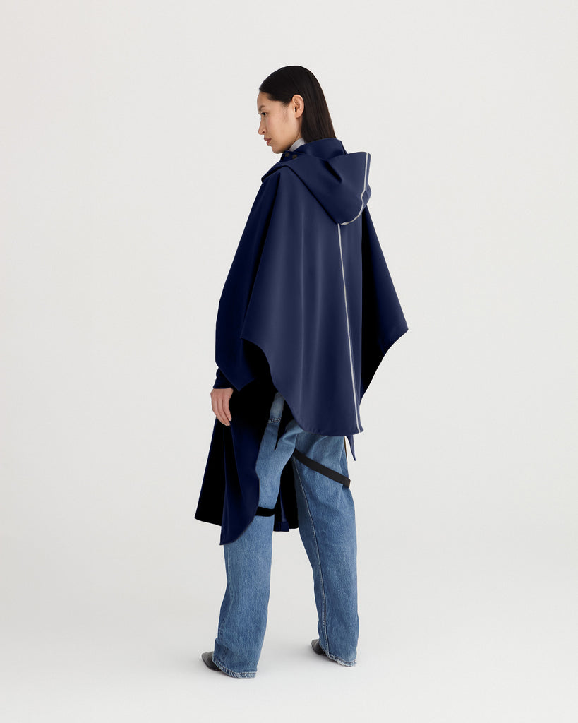 Navy blue, waterproof, breathable, technical, sustainable and packable raincoat poncho suitable for cycling