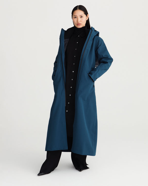 long, blue, waterproof, breathable, technical and sustainable winter warm raincoat with recycled, detachable liner.
