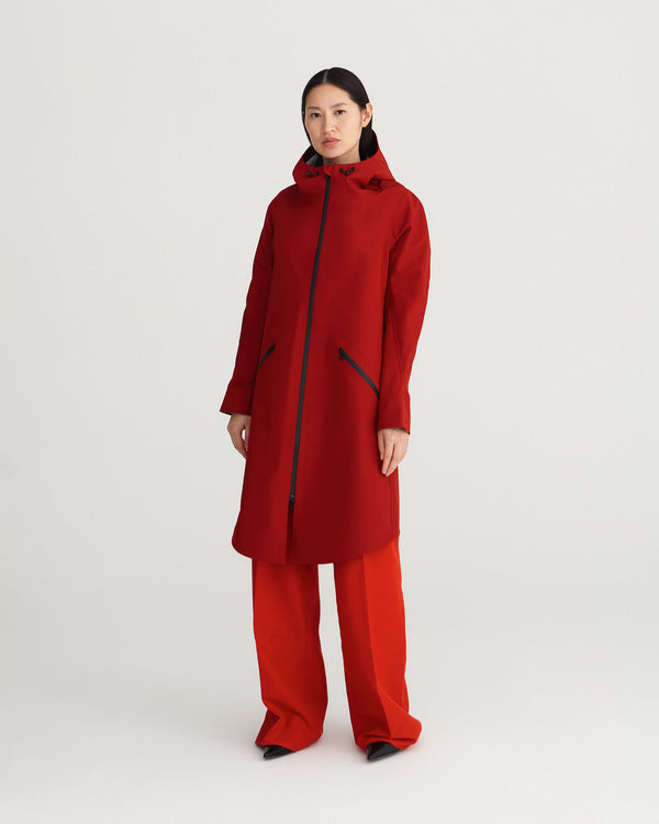 midlength, red, waterproof, breathable, sustainable and technical raincoat from recycled materials with hood.