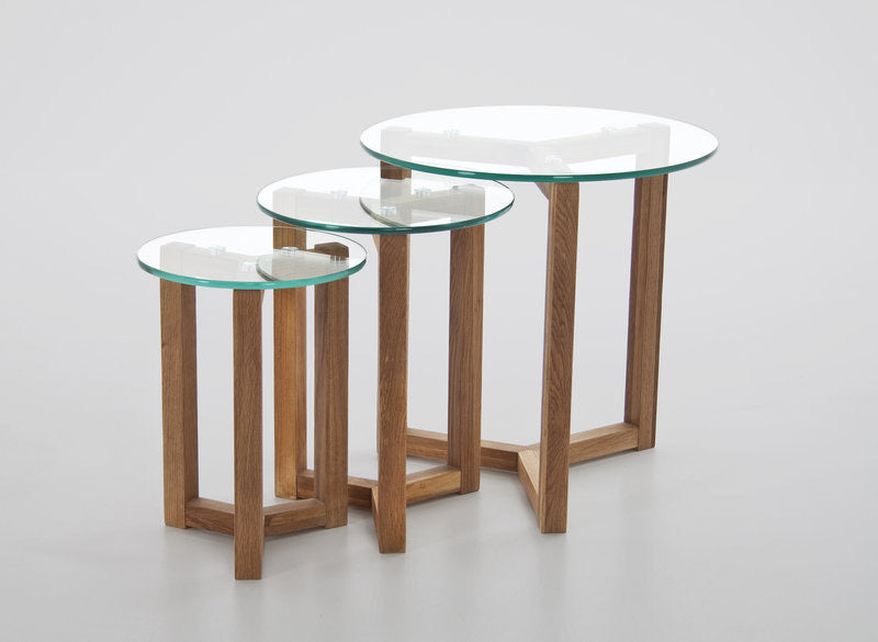 clear glass nest of three circular tables