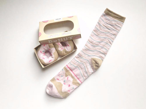 Food socks that make a creative gift. These donut socks look and are packed as if they are tasty donuts from Pomelo Socks