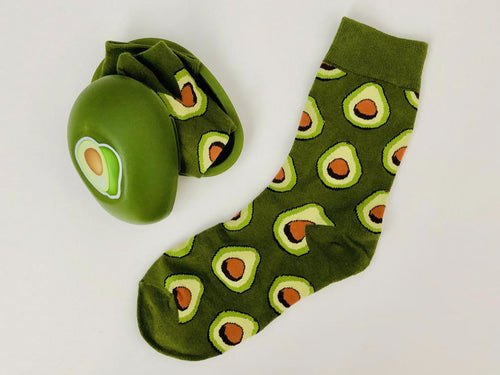 Adorable avocado socks that any avocado lover would enjoy as a gift.  Avocado socks come in their own avocado shaped container from www.pomelosocks.com.  Unique food socks for a creative gift.