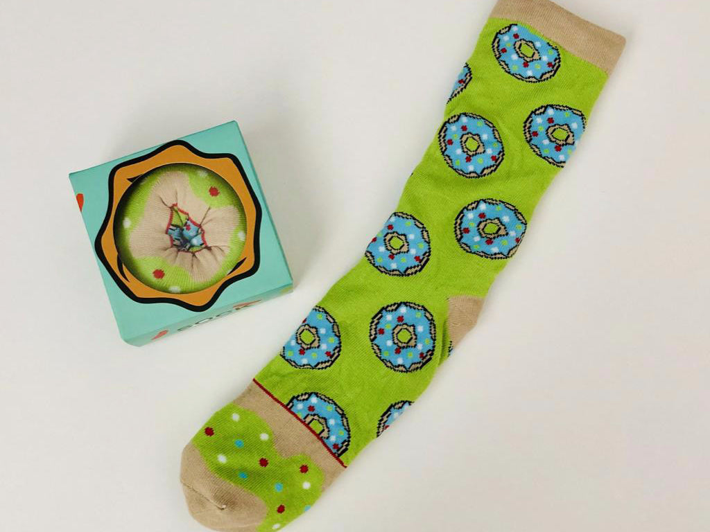 Food socks that make a creative gift.  These donut socks look and are packed as if they are a tasty donut from Pomelo Socks