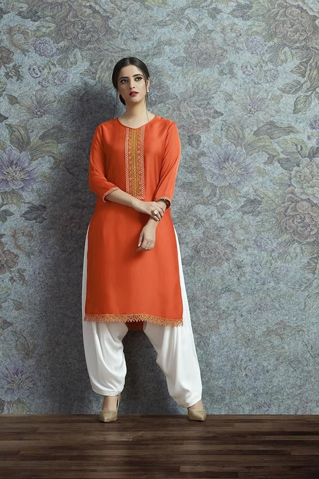Kurti In Orange Color Paired With White Colored Bottom STC9052