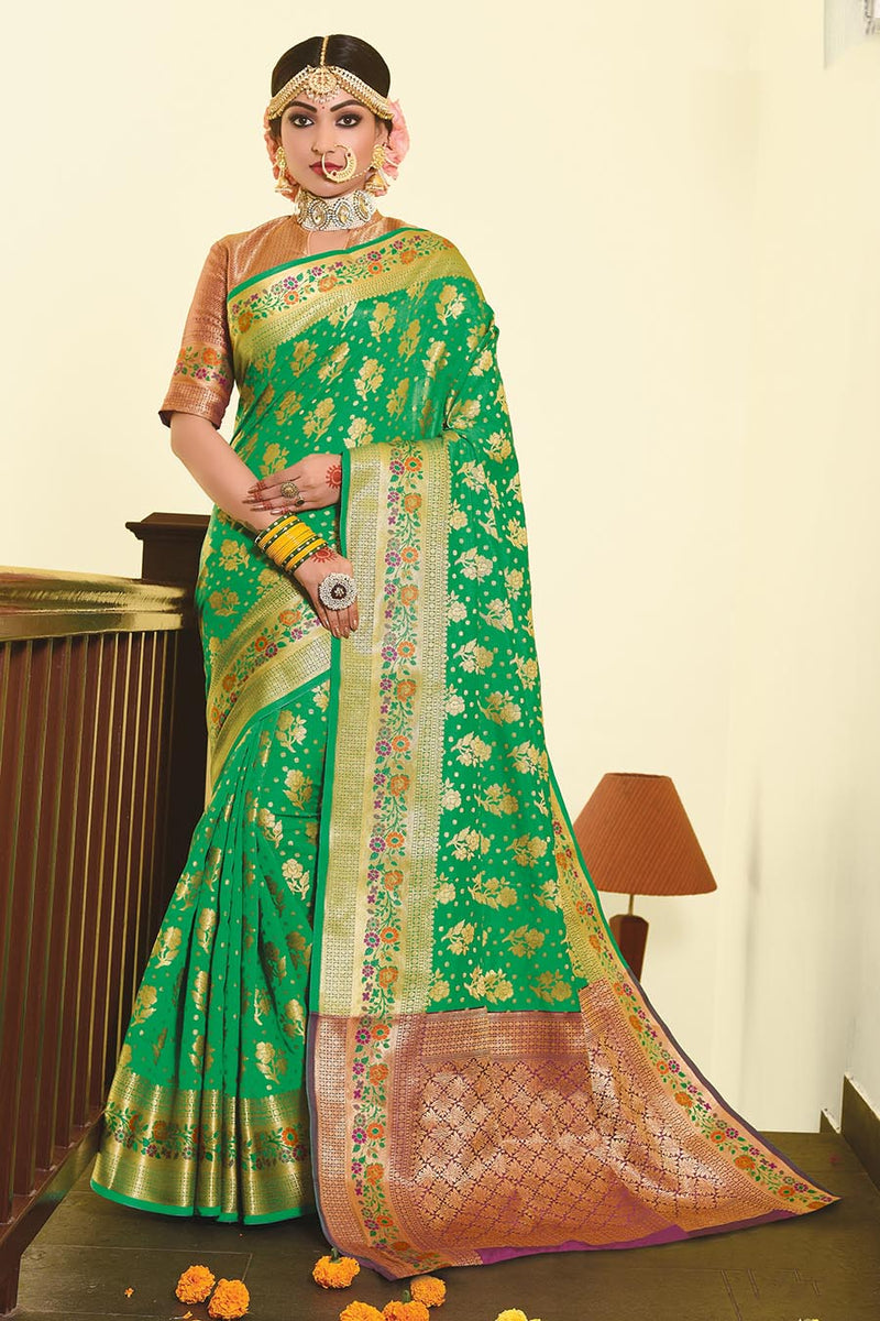 Designer Silk Based Saree In Green Paired With Contrasting Purple Blouse STC3025