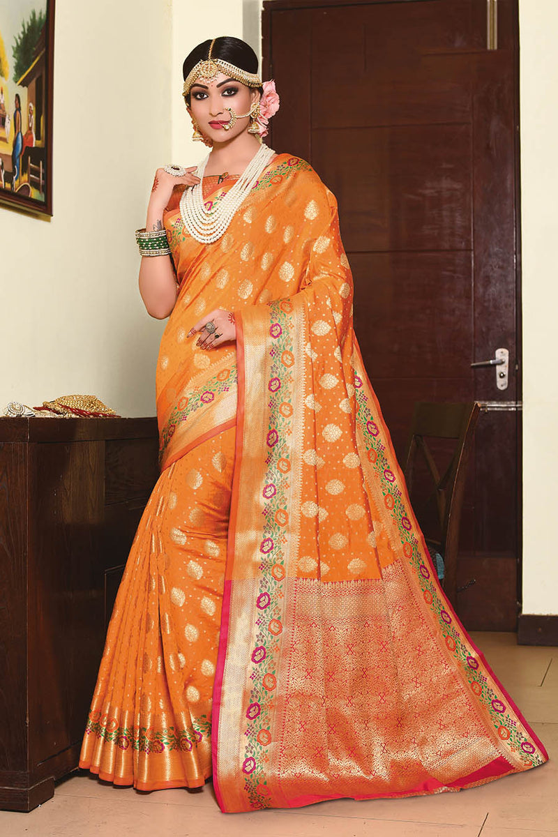 Designer Silk Based Saree In Orange Paired With Contrasting Dark Pink Blouse STC3027