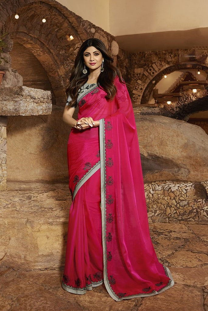 Attractive Looking Rani Pink Saree Paired With Grey Blouse STC3116
