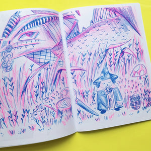 "A5 comic book. The cover title reads: Bark Mage and Friends, Vol. 1"". The cover image features Bark Mage, a magical dog in a wizard outfit, walking through a forest.The comic is printed in blue and pink riso ink colours."