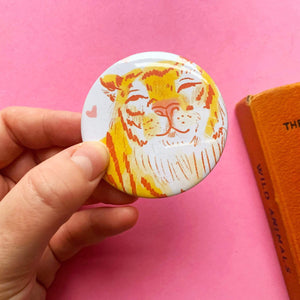 Large button badge. It features an ink illustration of a cute smiling chonky tiger against a white background.