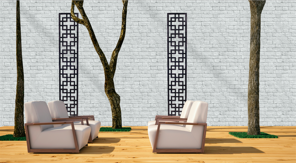 Two Black art deco inspired geometric trellises by Screen With Envy installed on a wall in an outside seating area