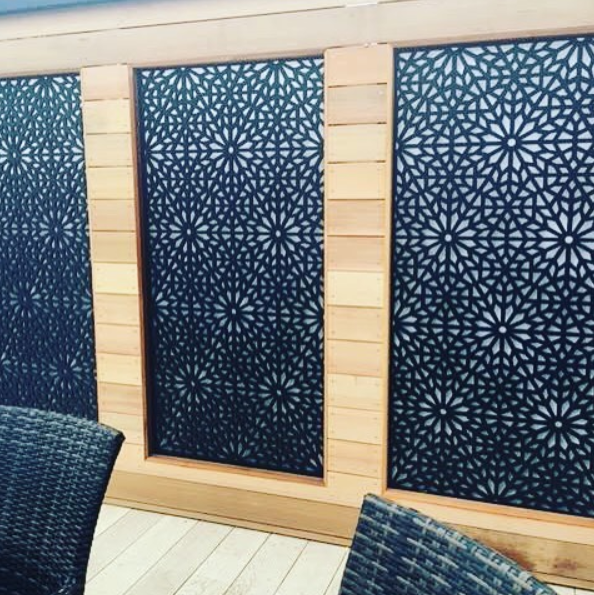 Black designer geometric screen by Screen With Envy installed in a show home garden