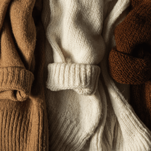 Close up of brown, white and burgundy knitwear